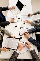 Image of business people hands with ballpoints writing on papers while planning work