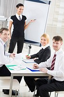 Portrait of smiling business partners looking at camera during meeting in office