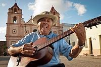 Man with Spanish guitar singing in ´Plaza del Carmen´ , Camaguey, Cuba, Caribbean