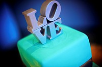 Blue wedding cake with LOVE topper