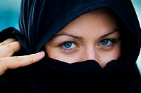 Girl with arabic clothes. Blue eyes.