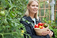 Woman with freshly picked tomatoes