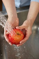 Woman washing apple