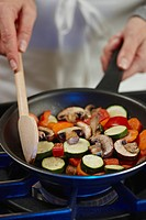 Woman stir_frying vegetables