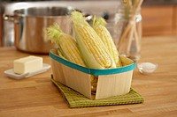 Basket of raw corn on the cob