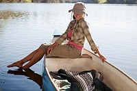 Woman canoeing on lake