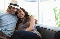 Young couple relaxing on the sofa (thumbnail)