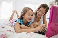 Girls sharing laptop computer
