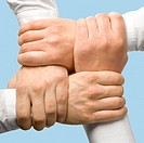 Photo of business peoples hands touching each other