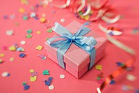 Pink present with blue ribbon against pink background