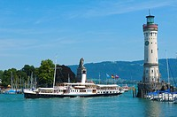 Harbor entrance with paddlewheel steamer Hohentwiel in Lindau, Lake Constance, Bavaria, Germany, Europe