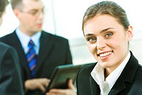 Photo of confident beautiful secretary on the background of people