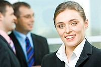 Face of young business woman looking at camera
