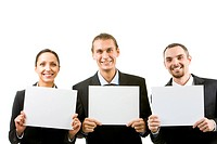 Row of happy business partners holding blank papers and looking at camera