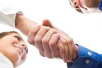 View down of business people handshaking and making agreement