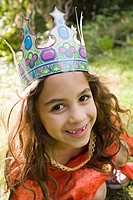 Girl wearing crown dressed up as queen (thumbnail)