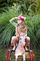 Girl in Native American costume on rocking horse