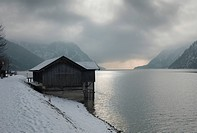 Wooden house in the snowy landscape, Achensee Lake, Austria, Europe