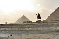Bedouin on dromedary in front of the Pyramisd of Menkaure and of Chephren, Giza Pyramids, Cairo, Egypt, Africa