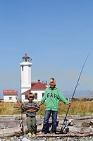 Children fishing, Fort Worden State Park, Port Townsend, Washington State, USA
