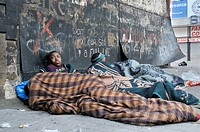 Street children, wrapped in blankets against a dirty wall, Hillbrow, Johannesburg, South Africa, Africa