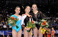 Kim Bui, Germany, centre, victory ceremony for uneven bars, Bruna Leal, Brazil, left, Marta Pihan_Kulesza, Poland, right, EnBW Gymnastics World Cup 20...