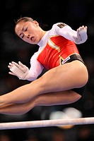 Kim Bui, Germany, performing on the uneven bars with hand protection for the high bar and uneven bars, EnBW Gymnastics World Cup 2009, Porsche-Arena, ...