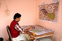 Indian man drawing a pattern on a carpet in a carpet-weaving factory, Jaipur, Rajasthan, North India, India, South Asia, Asia