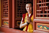 Budhist monk doing the traditional greeting in a temple  Lama Temple, Xian, Shaanxi, China