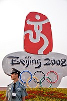 Beijing olympics symbol in Tiananmen square, guarded by a policeman  Beijing, China