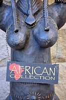 Female wooden figure outside an African fashion and jewellery shop, Capetown, South Africa, Africa