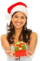 Christmas woman wearing a santa hat smiling with a gift isolated on white