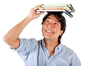 male student with notebooks on top of his head isolated over a white background