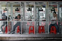 People making calls from phone booth Guangzhou, China September 2009