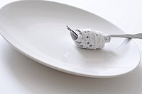 Fork with measuring tape on a plate