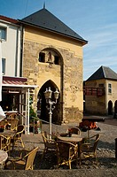 Outside bar in front of an ancient castle gate, Valkenburg, Limburg, The Netherlands, Europe