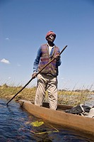 A mokoro is a boat made out of wood in the old times and of fiberglass nowadays, in wich kavango people travels in the Okavango Delta through the chan...