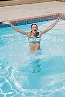 Preteen girl enjoying a day at the swimming pool