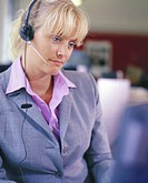 Female office worker wearing headset