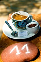 Espresso coffee and chocolate mousse with Pebbles with numbers to put on restaurant tables Normandy France