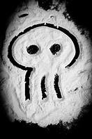 Skull shape drawed on white powder similar to cocaine