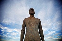 One of artist Anthony Gormley's 100 statues covering three by one kilometres of Croston beach, Merseyside