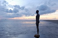 One of artist Anthony Gormley's 100 statues covering three by one kilometres of Croston beach, Merseyside,England