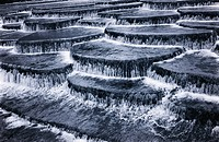 Monochrome image of cascade waterfall