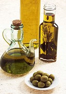 OLIVE OIL BOTTLE, AND GREEN OLIVES olea europaea