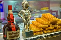 The Manneken_pis in a shop selling waffles during the Christmas market on the Champs Elysées