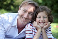 Germany, Bavaria, Father and daughter 8_9 Years having fun at picnic, smiling, portrait
