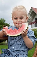 Germany, Munich, Girl 2_3 Years eating slice of watermelon, portrait