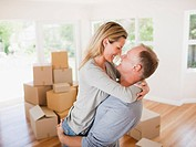 Couple hugging in new house
