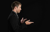 Mid adult man gesturing, close up (thumbnail)